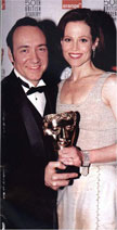 Kevin Spacey with Sigourney Weaver (and her award) at the 1998 BAFTA  Awards